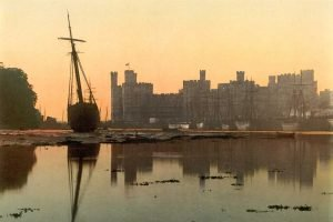 A Victorian Photochrom of Caernarfon Castle at Sunset