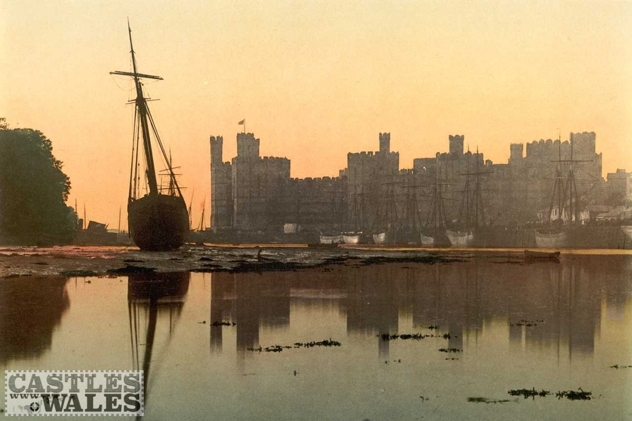 A Victorian Photochrom of Caernarfon Castle at Sunset